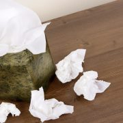 Kleenex box with wadded tissues