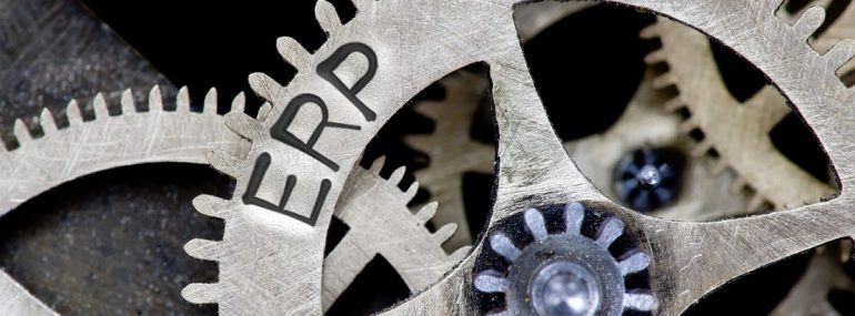 Macro photo of tooth wheel mechanism with ERP concept words