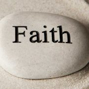 Rock with the word faith carved into it