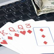 Winning card hand on computer keyboard with ten dollar bills