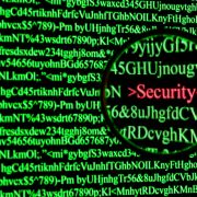 Magnifying glass over computer monitor highlighting word security