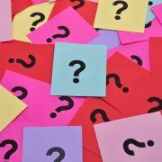 Pile of question marks on colorful sticky notes