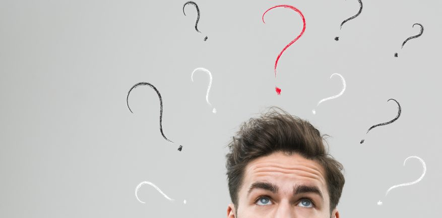 Man thinking with questions marks above his head