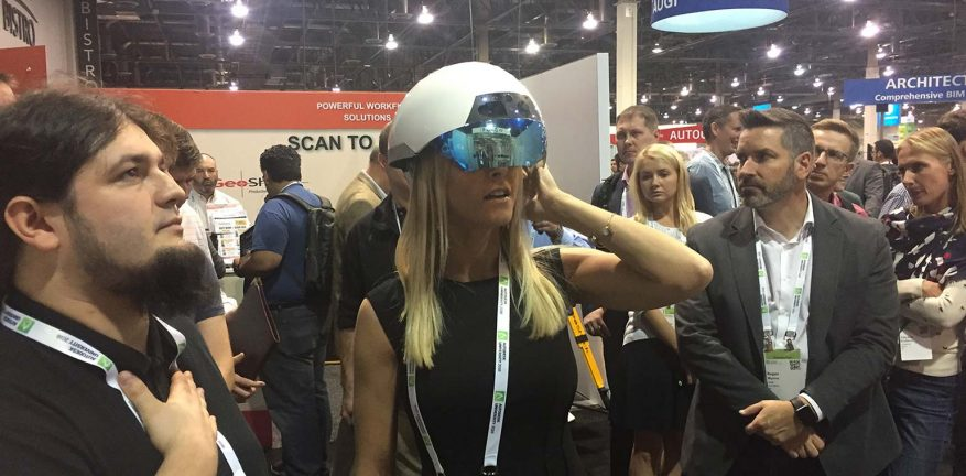 Penton regional sales account manager Emily Capaccioli tries out the DAQRI smart helmet at Autodesk University in November.