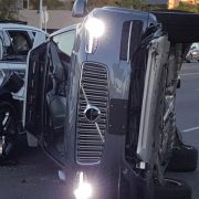 Self-driving uber on its side after a wreck in Tempe, AZ