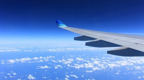 Image of wing of airplane in sky