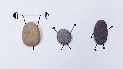 Image of rocks depicted with weights