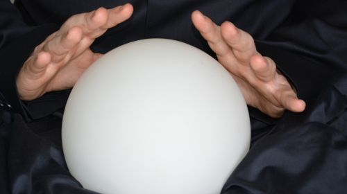 Image of person with hands over magic ball