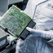 Image of Bosch worker holding a microprocessor