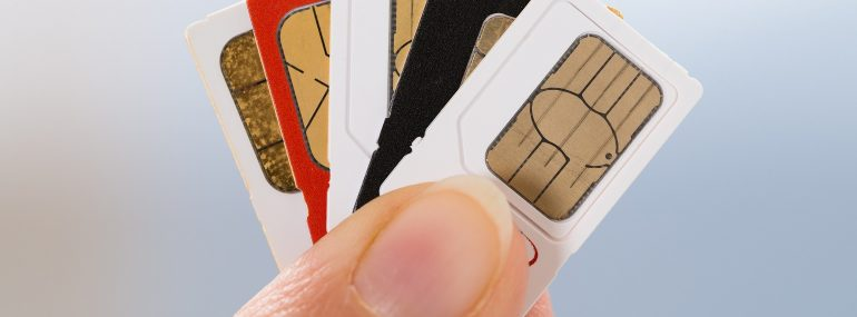 Image of fingers holding SIM cards