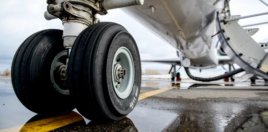 Picture of airplane landing gear on the runway