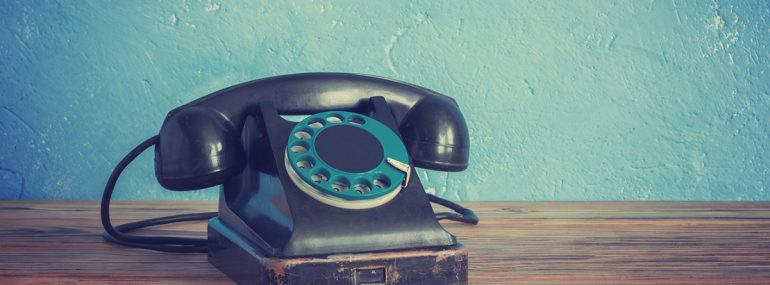 Vintage phone on a wooden table