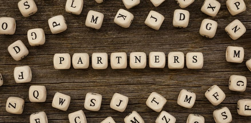 Word PARTNERS written on wood block, stock image