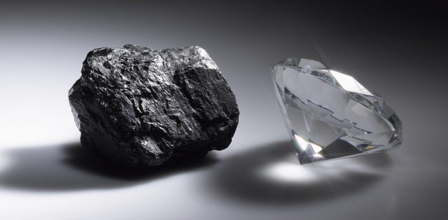 An image of a piece of coal alongside a diamond