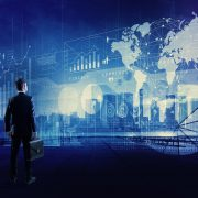 Image shows a businessman looking various graphics of business. Internet of Things.