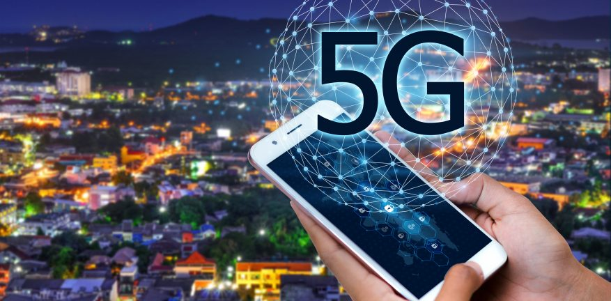 Image shows individuals using global communication phones in the 5g system