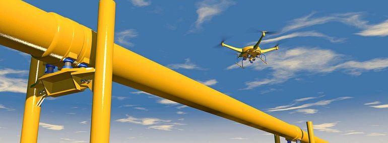 Image shows a drone inspecting oil and gas lines.