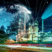 Image shows a modern factory and global communication concept.