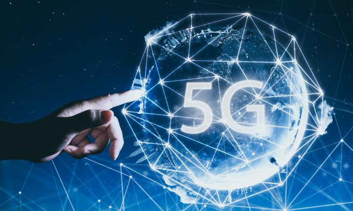 Image shows 5G network wireless systems and internet of things with man touching Abstract global with wireless communication network on space background .
