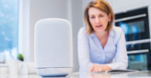 Image shows a woman talking to her virtual assistant.