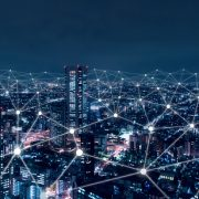 Image shows a telecommunication network above city, wireless mobile internet technology for smart grid or 5G LTE data connection, concept about IoT, global business, fintech, blockchain