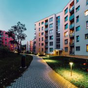 Apartment modern houses and homes residential buildings complex real estate concept. Street and outdoor. In the evening
