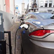 Image shows an electric car at recharging station.