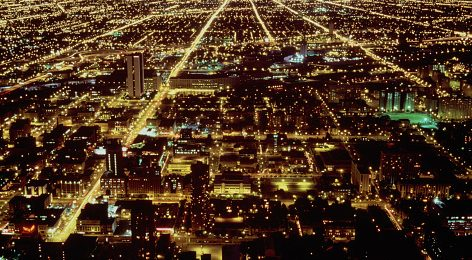 Image shows Chicago illuminated at night.